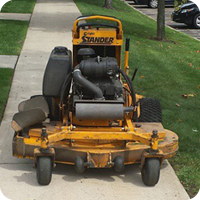 Landscape maintenance stand behind commercial lawn mower